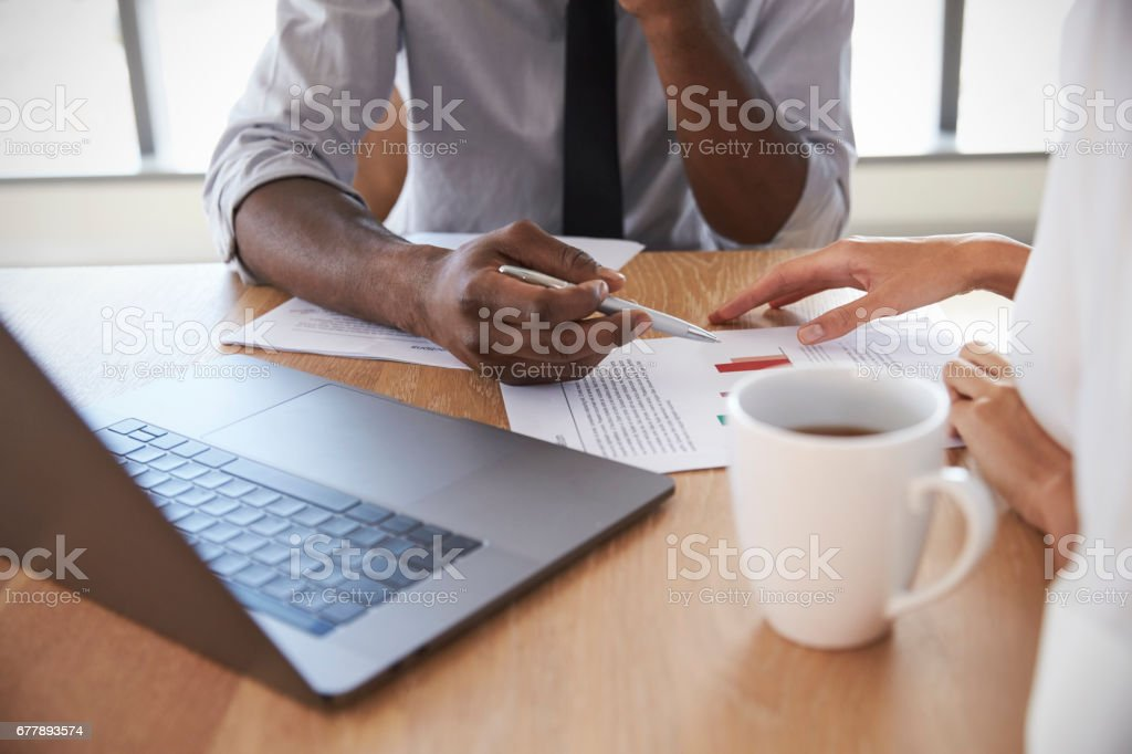 Close Up Of Businesspeople Working On Laptop In Boardroom royalty-free stock photo