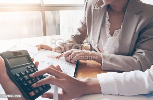 897852992istockphoto Close up of businesswoman or accountant hand holding pen working on calculator to calculate business data, accountancy document at office, business concept 1085669886
