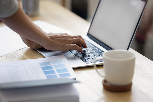672064598 istock photo Close up of businesswoman typing on laptop gadget 1256097782