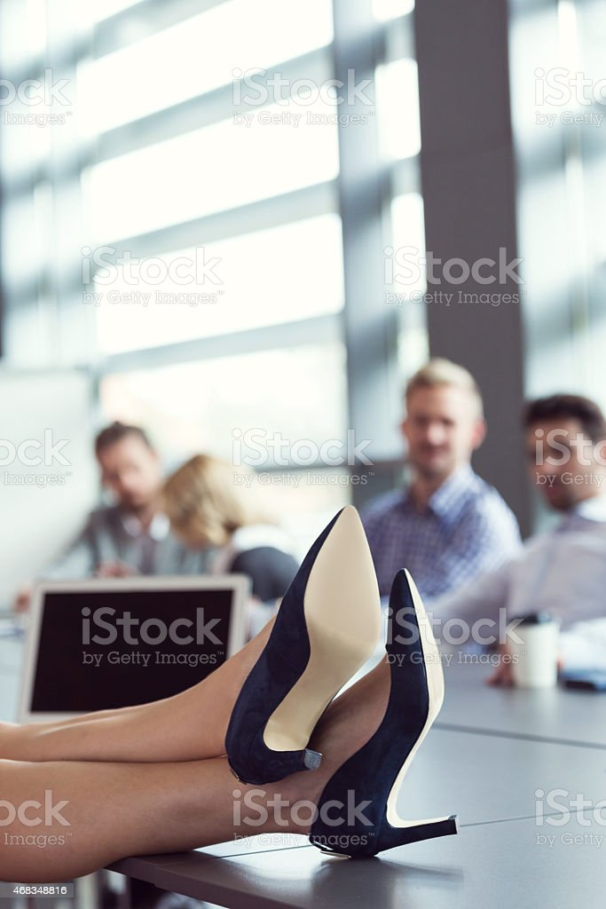 Close up of businesswoman's legs wearing highheels royalty-free stock photo