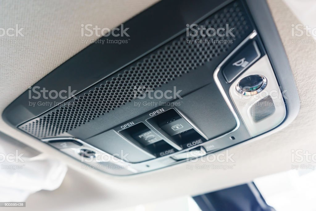 Close up of cabin lights switch in my car, light control panel inside...