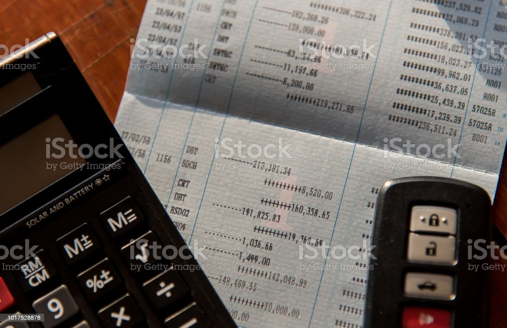 close up of calculator ,car remote and account book in finance and banking concept stock photo