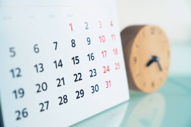 close up of calendar and clock on the table, planning for business meeting or travel planning concept - calendar imagens e fotografias de stock