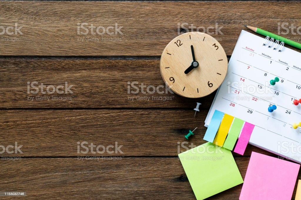 close up of calendar and clock on the table, planning for business meeting or travel planning concept - Zbiór zdjęć royalty-free (Alarm)