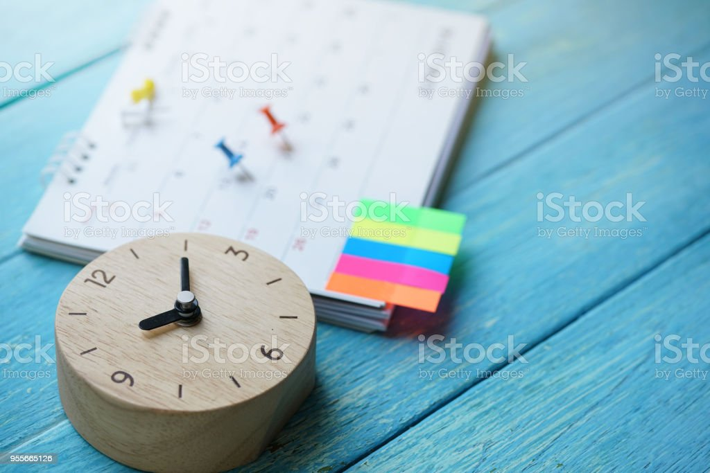 close up of calendar and clock on the table, planning for business meeting or travel planning concept stock photo