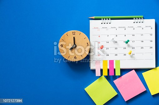 close up of calendar on the blue background, planning for business meeting or travel planning concept