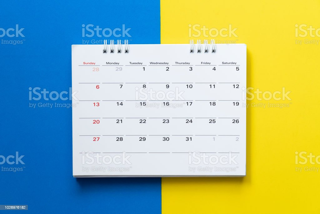 close up of calendar on the colorful table, planning for business meeting or travel planning concept stock photo