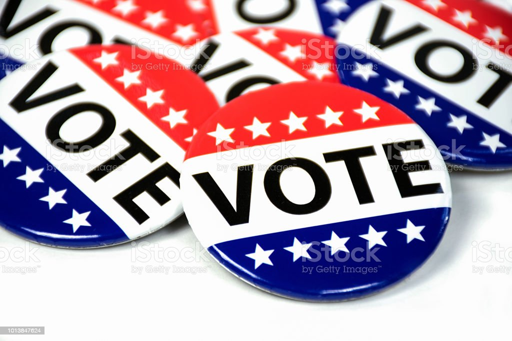 close up of campaign voting flag pins on white stock photo