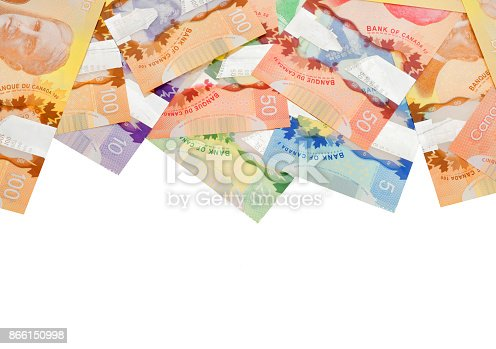istock Close up of Canadian banknotes (CAD) on white background 866150998