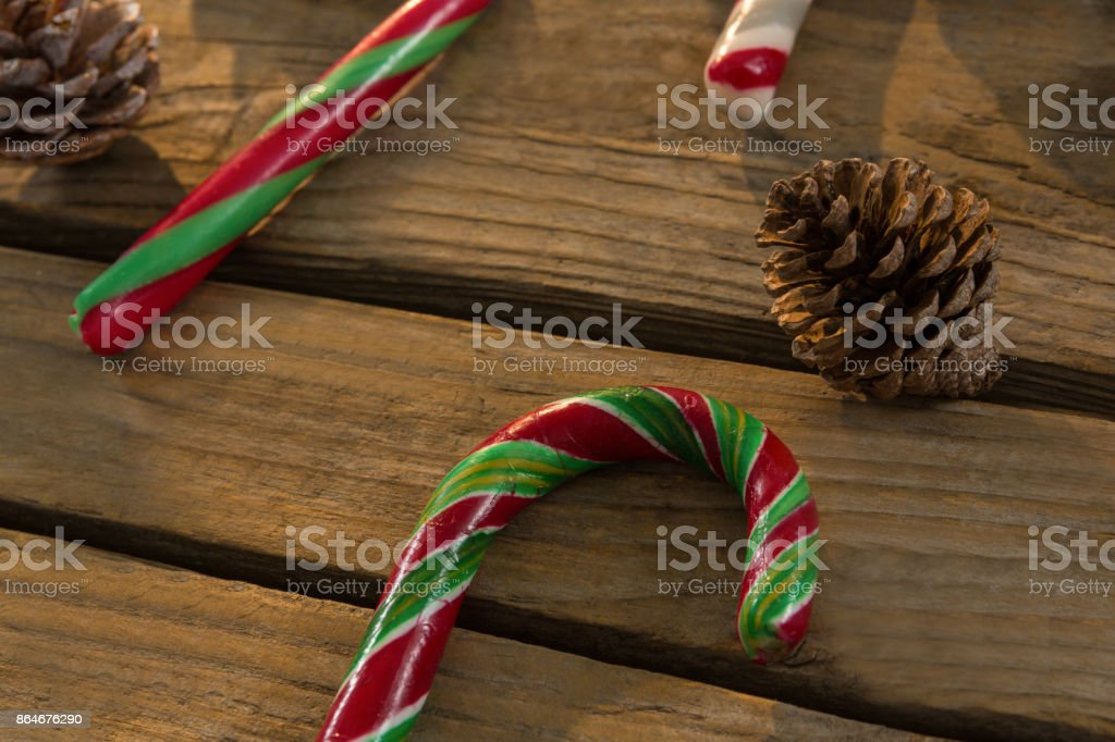 Close up of candy canes and pine cones on table stock photo