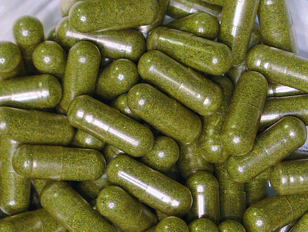 Close up of cannabis capsules in glass dish stock photo