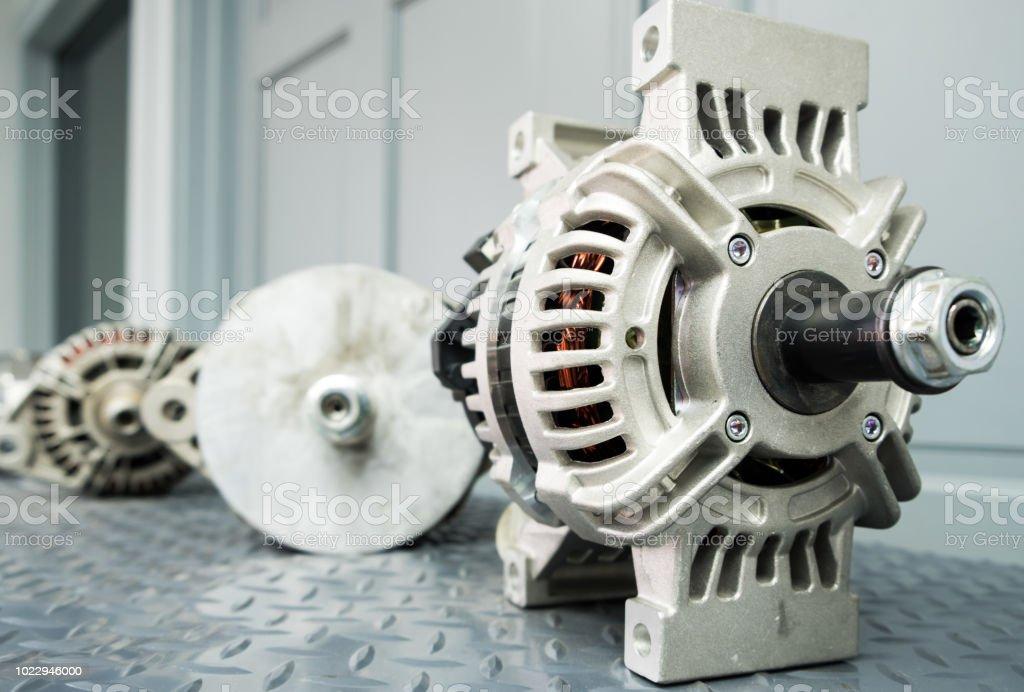 Close up of car alternator on display on metal shelf/auto parts stock photo