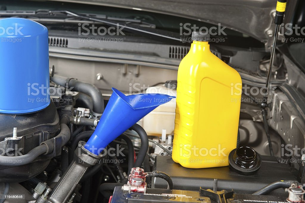 Close up of car engine with bottle of oil on top royalty-free stock photo