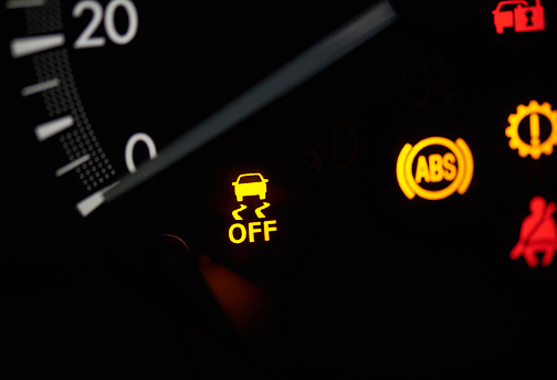 Close up of car speedometer  with yellow warning sign