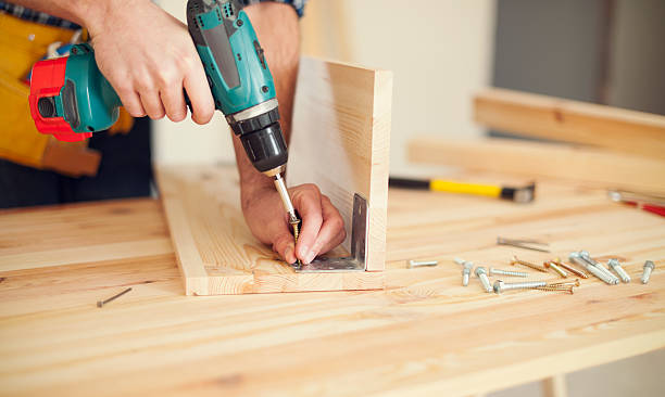 close up of carpenter working with drill - drill stock photos and pictures