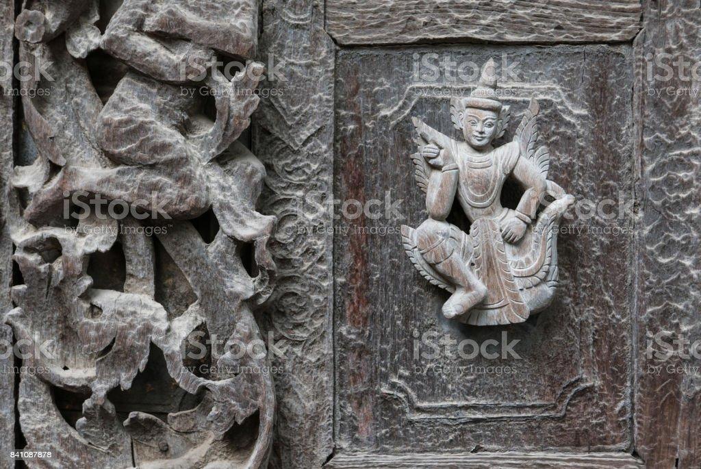 Close Up of Carved Figure on Exterior Wall, Shwenandaw Monastery, Mandalay, Myanmar (Burma) stock photo