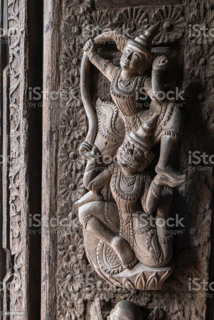 Close Up of Carved Figures on Door, Shwenandaw Monastery, Mandalay, Myanmar (Burma) stock photo