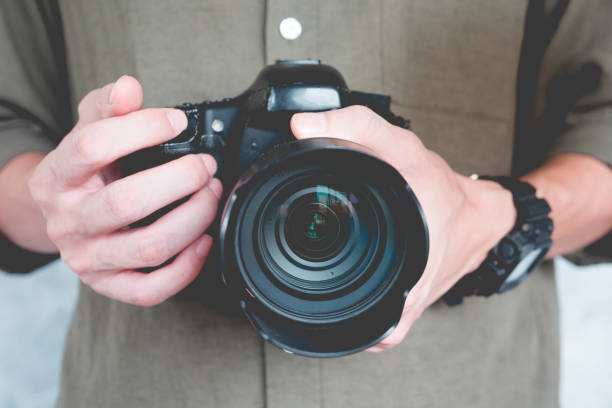 Close up of casual man is holding a camera, Photography Concept. stock photo