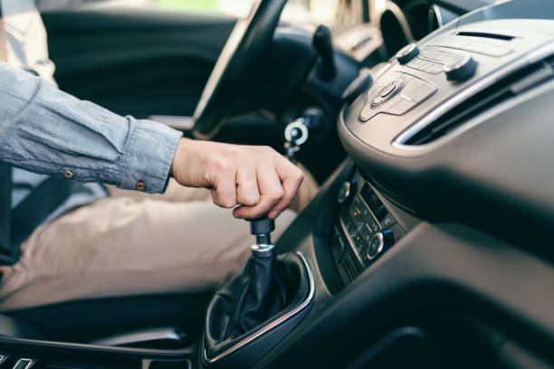 Close up of Caucasian man holding hand on gearshift. Close up of Caucasian man holding hand on gearshift. gearshift stock pictures, royalty-free photos & images