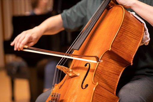 Close up of cellist playing at classical concert