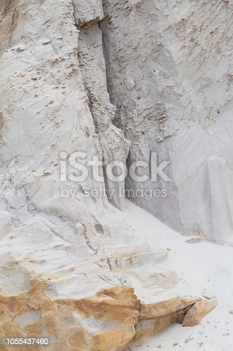 Close up of chalky, sandstone deposits on a crumbling decaying cliff on Brownsea Island, Poole Harbour, Dorset, Southern England
