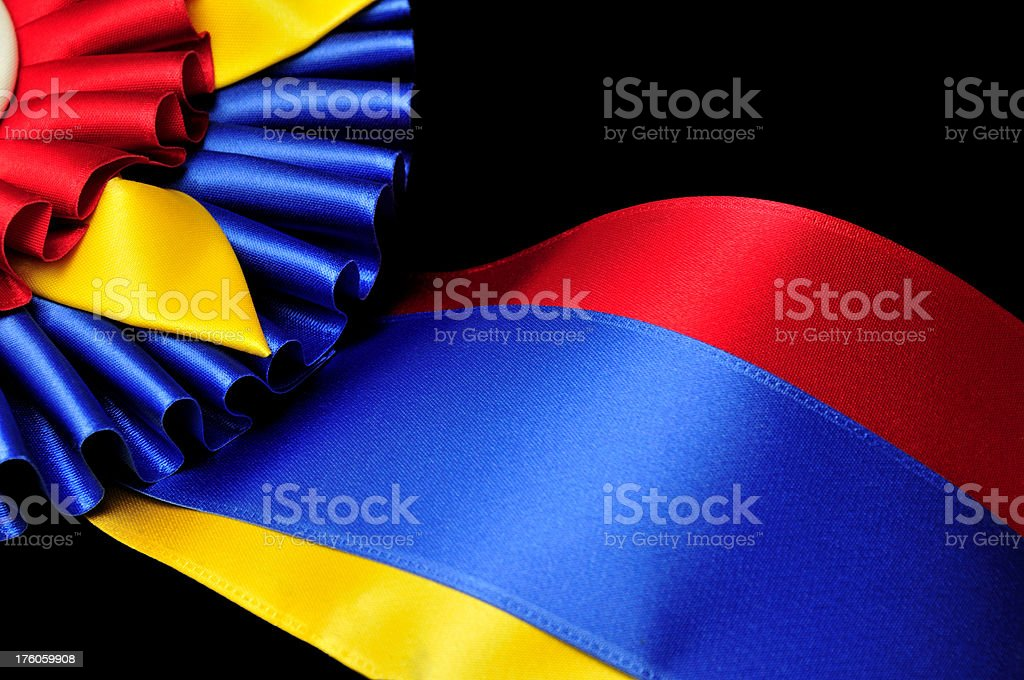 Close up of Champion Ribbon and Rosette on Black Background royalty-free stock photo