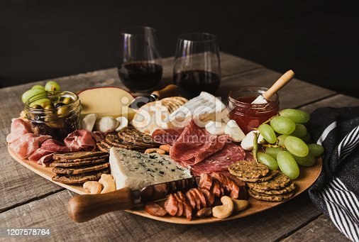 Close up of charcuterie board and glasses of wine on wooden table. in Kingston, ON, Canada
