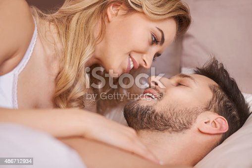 istock Close up of charming young couple during the foreplay 486712934