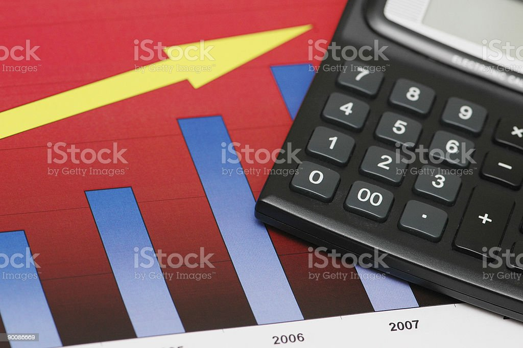 Close up of chart showing growth and calculator royalty-free stock photo