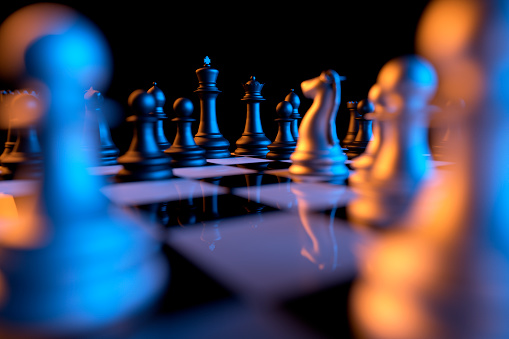 Close up of chessmen on chessboard with the focus on a queen