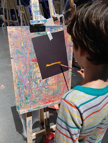 Close up of child painting