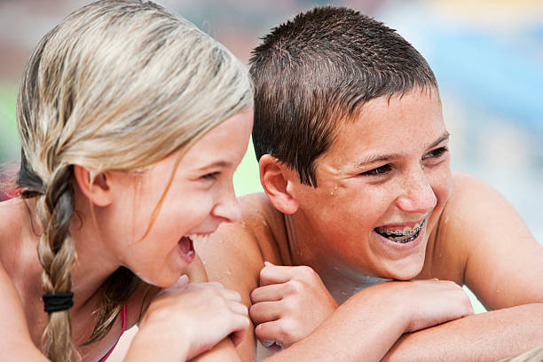 Close up of children laughing at pool stock photo