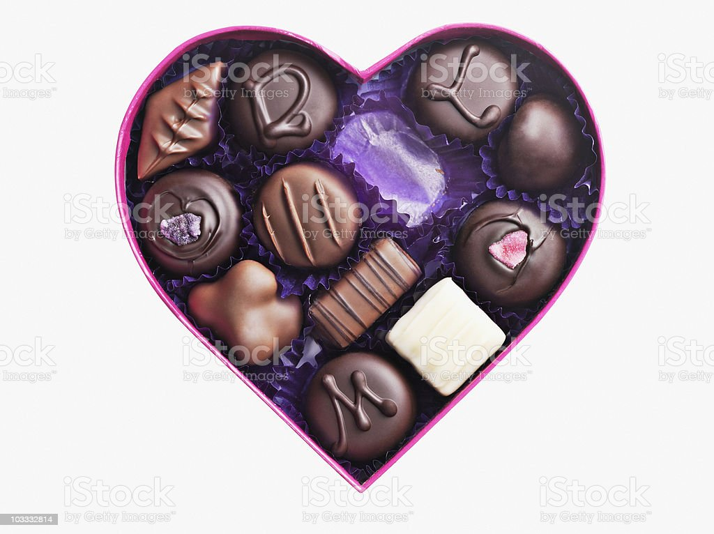 Close up of chocolates in heart-shape box stock photo