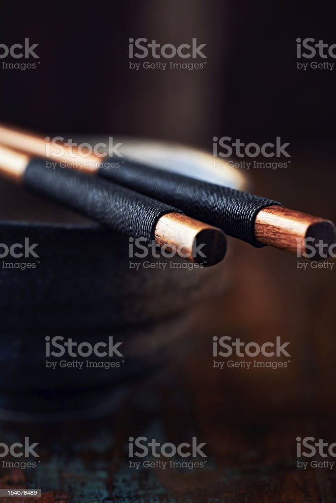 Close up of chopsticks on a ceramic bowl royalty-free stock photo