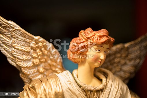 Close-up view of a Christmas angel figurine. Angel was mass-produced and purchased at a retail box store and it is not original artwork.