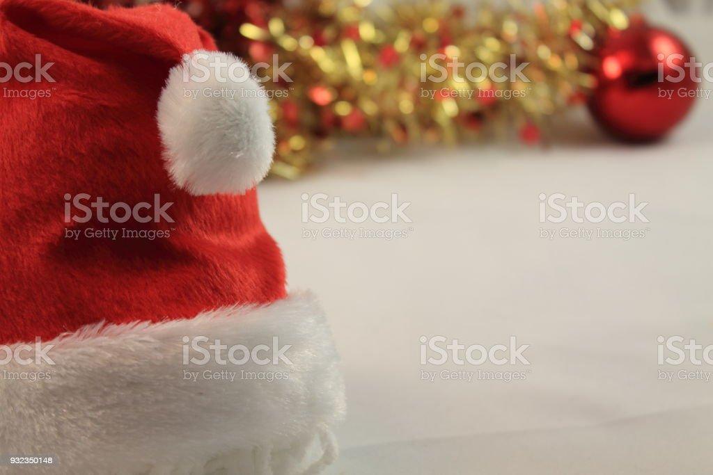 close up of christmas hat on white soft plush background with christmas decoration stock photo