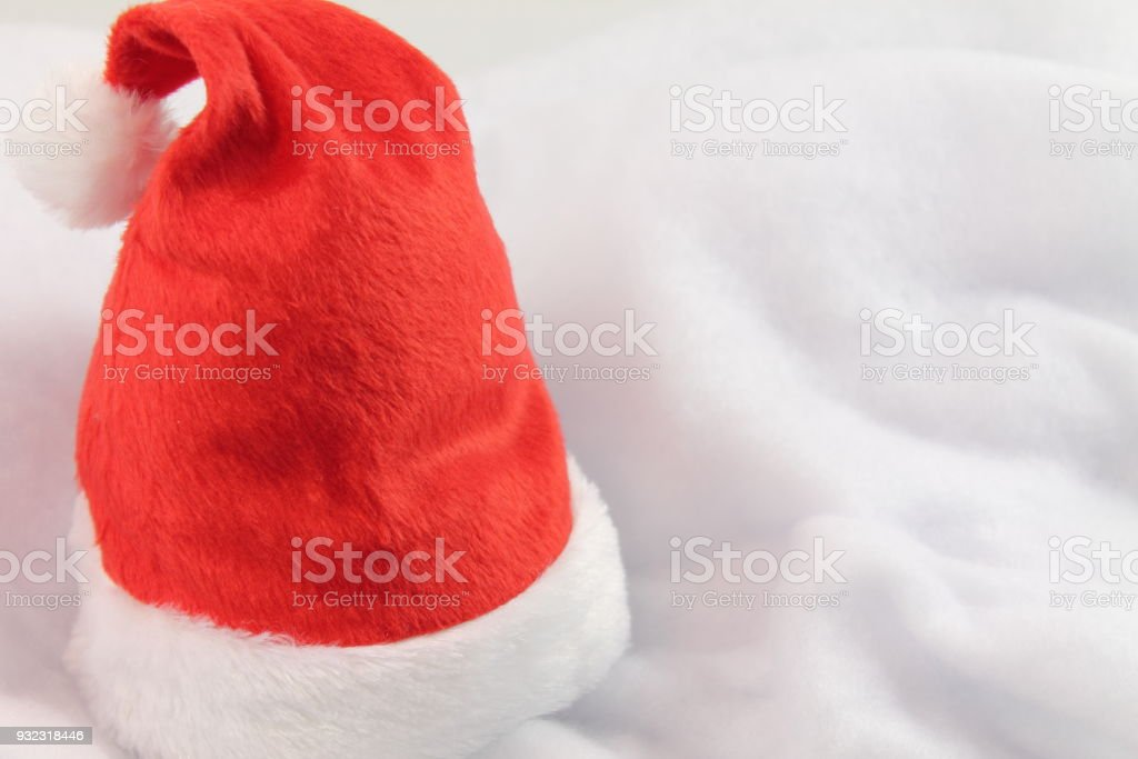 close up of christmas hat on white soft white fluffy background stock photo