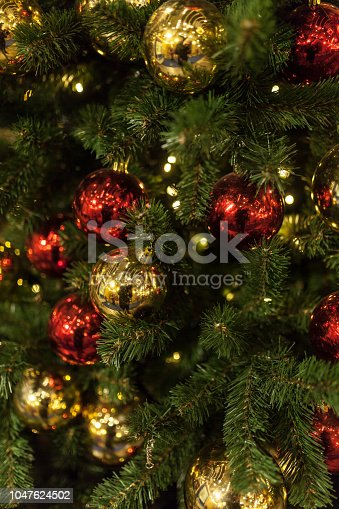 istock Close up of Christmas tree with ornaments 1047624502