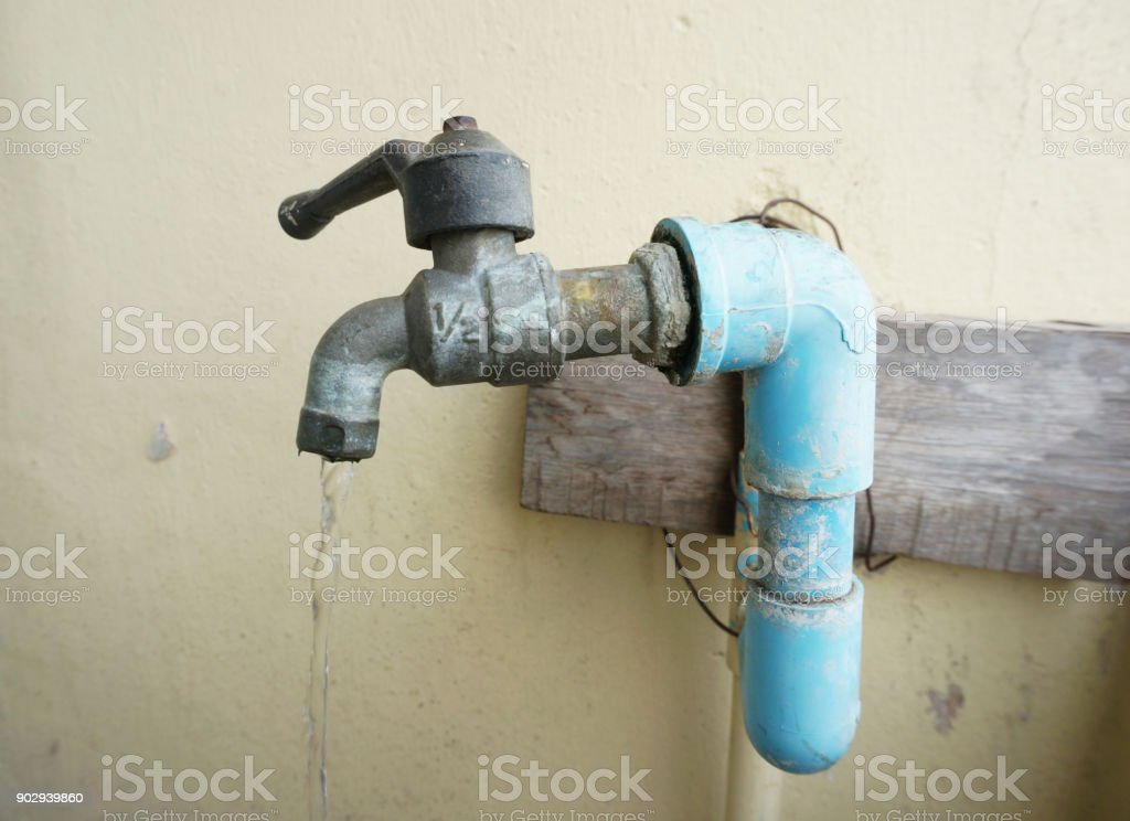 Close up of Chrome faucet and water pipeline stock photo
