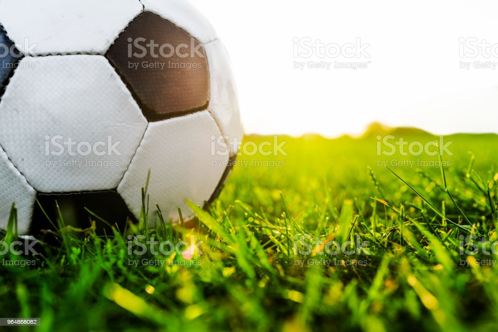 Close up of Classical old football on the field royalty-free stock photo