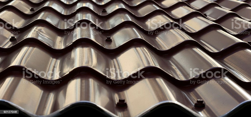 Close up of clean polished metal roofing tiles stock photo