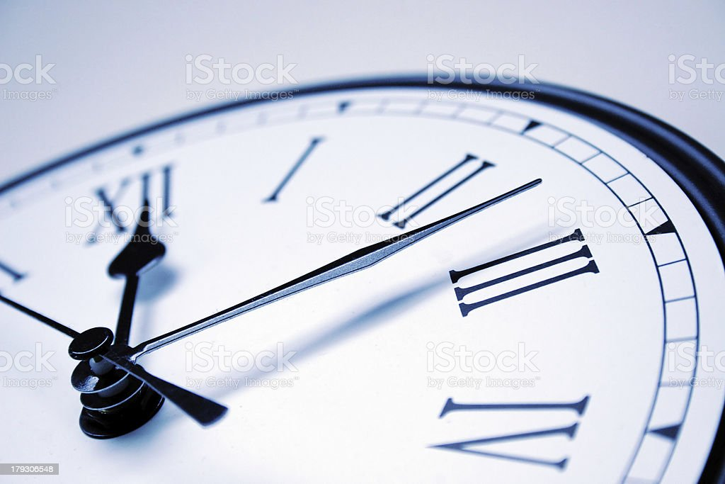 close up of clock with roman numerals stock photo