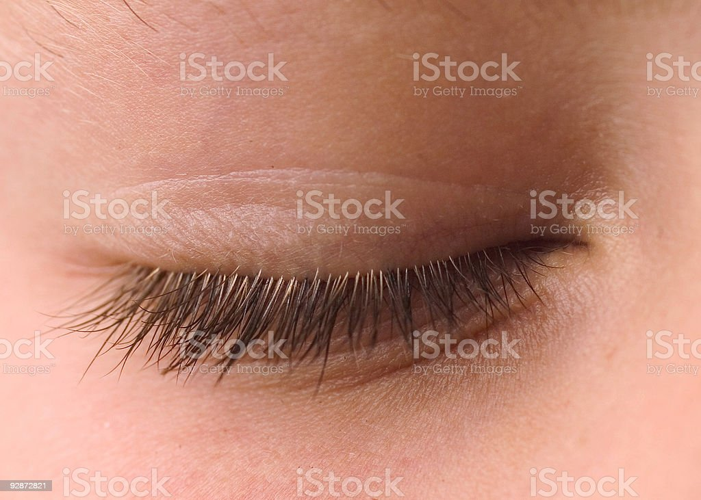 Close up of closed eye with eyelashes stock photo