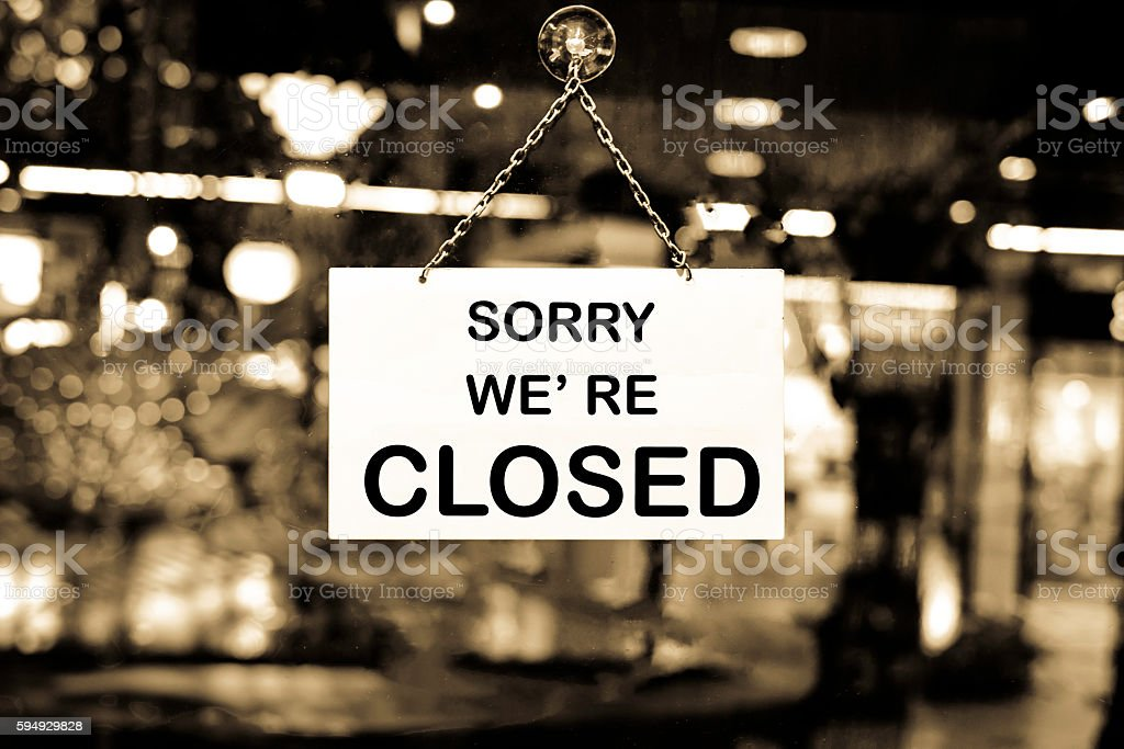 Close up of closed sign on shop door stock photo