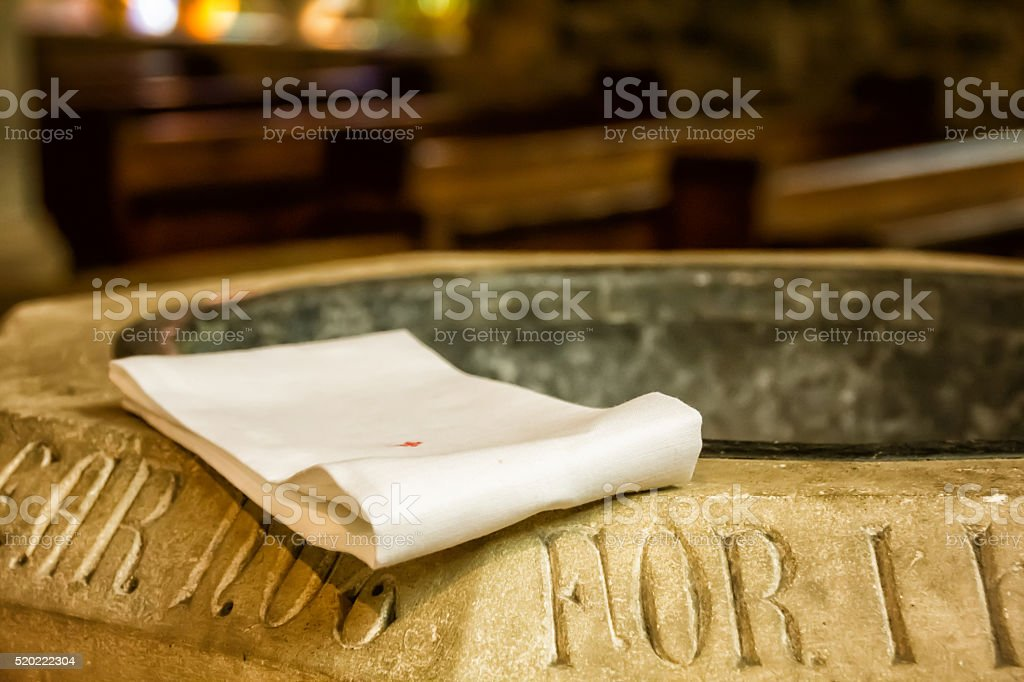 Close up of cloth on baptismal font stock photo
