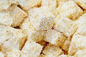 close up of handmade coconut marshmallow sweets, food background