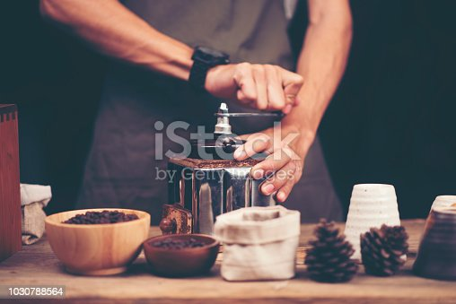 istock Close up of coffee brewing gadgets on wooden bar counter. 1030788564