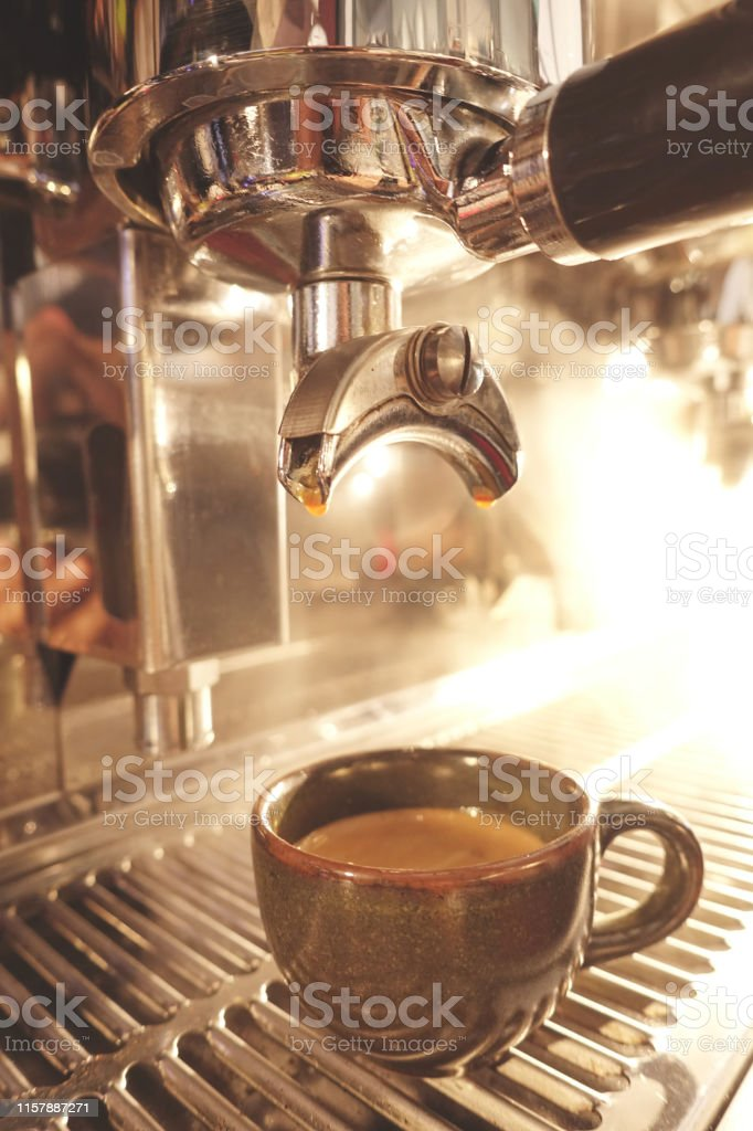 close up of coffee machine preparing cup of coffee
