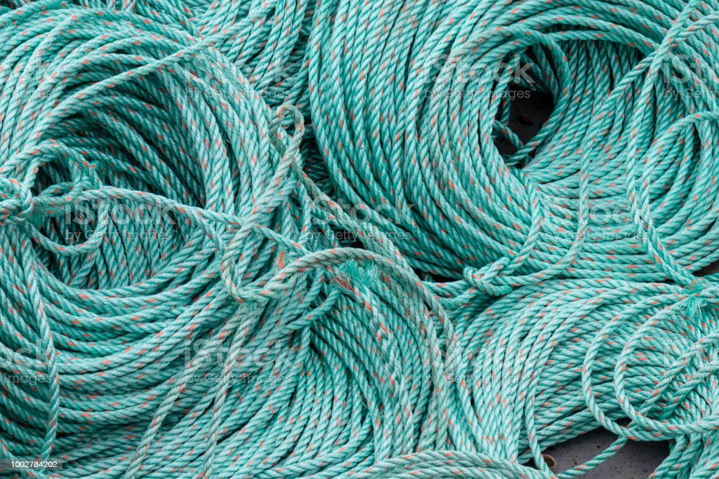 A close up of coiled synthetic ropes. stock photo