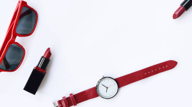 close up of color lipsticks and sunglasses with wrist watches – zdjęcie